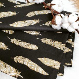 בד כותנה אורגנית – נוצות זהב על רקע שחור -גליטר